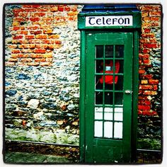 Dublin, Ireland: green door to telephone kiosk. Photo by DarcySparrow