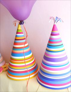 4 printable party hats in bright stripes (Mr. Printables): Fun party hats that would be great for any kids' party, including princess, circus or carnival birthday theme, mediaeval celebration, Dr. Suess party, and more!