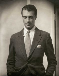 Dapper Gary Cooper. I wonder if he found that outfit in that closet he hung out in?