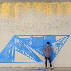 20 Year Old Gustavo Fuentes (aka Flëkz) is not your usual graffiti artist. This L.A. local creates large scale murals on the walls around the city without the aid of stencils, rulers or spray paint. His only material he uses to create his pieces is a roll of humble painter's tape.