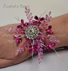 This stunning wrist corsage is handcrafted in  Pink Crystal Butterflies,Crystal Leaves,Diamante Brooch displayed on a Pink Pearl Bracelet www.designelementflowers.com