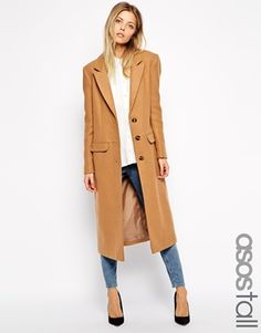 Winter weather can get pretty glim: elevate your outlook in a camel-colored coat instead of boring ol' black