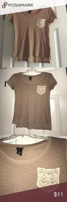 Rue 21 top! NWOT. Never worn. Very cute top with a lace pocket. Pet and smoke free home. Rue 21 Tops Blouses