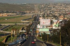 Tijuana, Mexico ~ The most visited border town, is to the right, and the US border can be seen to the left of the highway in this picture.  Past the border, part of San Diego, California, is visible.