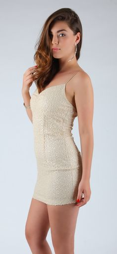 Pearly shimmering sequins enrich this gorgeous mini bodycon dress with red-carpet glamour.