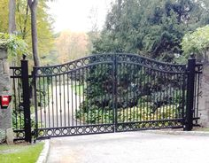 Automated wrought iron 4-rail entrance gate with decorative scrolls