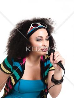 image of a young female singer with microphone. - Close-up image of a young female singer with microphone. Model: Taylor Chmiel