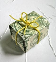 Paper money folded into gift box