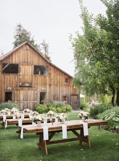Picnic tables take an elegant twist: http://www.stylemepretty.com/california-weddings/santa-cruz/2015/03/23/rustic-elegant-barn-wedding-in-santa-cruz/   Photography: Jana Williams - http://jana-williams.com/