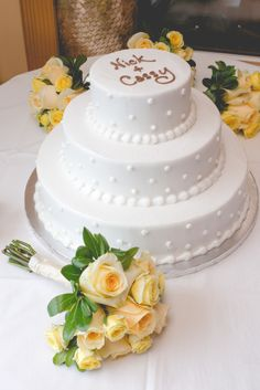 dotted white wedding cake and yellow roses captured by Blueberry Fields Photography http://www.blueberryfieldsphotography.com/