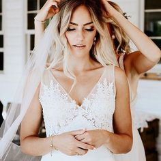 Finishing touches ✨ Love getting ready photos! Beautiful dress with perfect loose curls, captured here by @kensiewebster ✨ Tag someone you know who would love this! More dresses on our site, link in bio. . .
