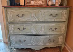 I painted it with Miss Mustard Seed's Milk Paint in Boxwood and then white waxed it with her white  wax