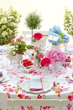 """David Stark Designs using D. Porthault to brighten up this tablescape. You can find this inspiration and more in his new book """"The Art of The Party."""" To get yourself a copy, call 212-872-2570."""