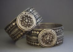 A luminous pair of Yemeni silver bracelets with wonderful filigree and granulation.  Likely Jewish made in the first half of the 20th century, and worn above or below the elbow as an armlet.  Posted by Betty on Ethnic Jewels.