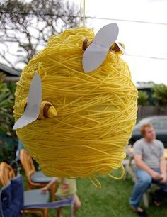 "Bee Pinata... you could take round pinata and cover design in yellow yarn and put a few bees on the ""hive""... if you don't want to do a pinata, then you could cover balloons or styrofoam or something of the shape and hang around as decor."