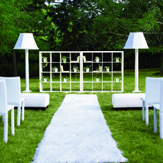 "Brides.com: Ceremony Altars for Outdoor Weddings. Living Room It's easy to make your ceremony feel like home: Bring the indoors out! Comfy seating and a shag runner create a welcoming setting for guests, while side-by-side bookcases dotted with potted ivy and books covered in wrapping paper provide the perfect backdrop for your I do's.""Expedit"" bookcases, $129 each, and ""Skurar"" lacy planters, $4.99 each,  Ikea. Lamp shades, $449  each, Lexington Lampshade; 212-249-0139. Lamp bases, ..."