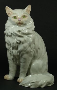 Dresden German porcelain sculpture depicting a easted cat with green eyes