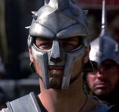 Russell Crowe wearing Maximus' helmut in the Gladiator movie