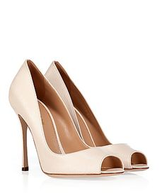 A sleek choice in textured ivory leather, Sergio Rossi's peep-toe pumps lend impeccable style to any ensemble #Stylebop