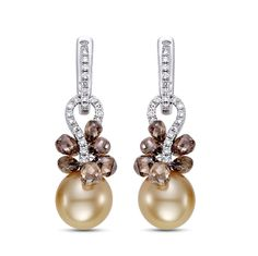Mastoloni Cognac Ice Earrings feature 13mm golden South Sea pearls. The drop-shaped pearls are natural color. Cognac-color diamond briolettes shower the rich, candy-colored pearls. The pearls drop 1 inch from the ear; suspended from 18kt white gold lever backs.
