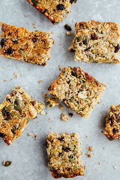 Protein Breakfast Bars made with dessicated coconut, hemp sesame and pumpkin seeds, mixed nuts, raisins, cashew butter and maple syrup or date paste (Vegan)
