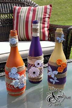 tiki wine bottles, design d cor, diy home crafts, repurposing upcycling, Add a pop of color like I did with the purple to create some pop to your space Wine Bottle Corks, Glass Bottle Crafts, Diy Bottle, Painted Wine Bottles, Bottles And Jars, Decorated Bottles, Glass Bottles, Wrapped Wine Bottles, Wine Craft
