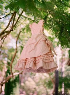 peachy pink dress with ruffles and bow