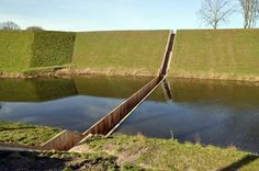 Sunken bridge at Fort de Roovere near Halsteren. Unlike a traditional bridge, this goes through the water instead of over it and this creates a stunning look.