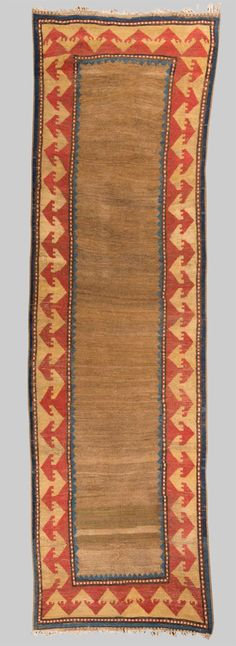 Grogan and Company | SOUTH CAUCASIAN RUG, first half 19th century; 10 ft. 2 in. x 2 ft. 11 in.