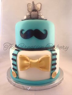 Little man baby shower cake with suspenders, bow tie, mustache, and a 3D elephant cake topper.