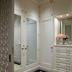 On right of photo: Built in drawers, marble counter top, mirror and pot-light