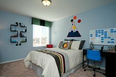 This kid's room from Lennar Colorado has fun with science and also features a practical desk to do homework at