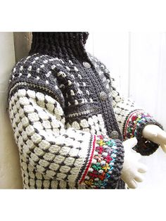 A beautiful crocheted cardigan embellished with colorful embroidery will be a real eye-catcher. This design is worked from top-down in 1 piece. Instructions include step-by-step photos, symbol crochet and written instructions. It is made using a DK-w...
