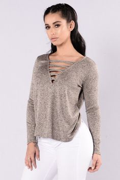 - Available in Taupe and Heather Grey - Sweater - Long Sleeve - V Neckline - Criss Cross Front - Loose Fit - Made in USA - 81% Polyester 15% Rayon 4% Spandex