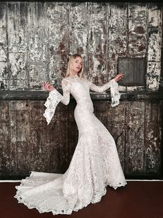 7145147609 Belle/ Jack Sullivan. This Australian Designer gown is available at Nifi  Birdal. Book