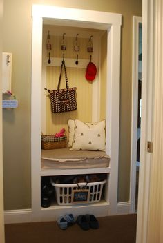 'mud room'...take the door of a closet and put in a bottom shelf.