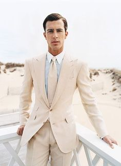 Cream men's suit and tie with sky blue shirt