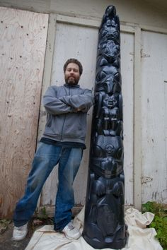 Haida artist Gwaai Edenshaw stands with the first in an edition of seven of his impressive bronze pole depicting the heroic legend of Stone ...