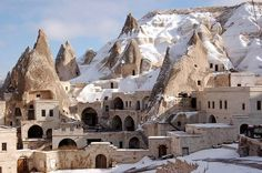 """Goreme, Turkey.  If you want to see the word's most beautiful monasteries and cave churches, then you must certainly visit Goreme. This quaint little village went by different names in history, but it's most known for the """"fairy chimney"""" rock formations in its terrain."""