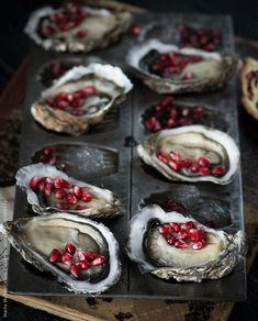 via ill-mannered on tumblr: Oysters with fresh pomegranate By MartaMCAvailable to license exclusively at Stocksy