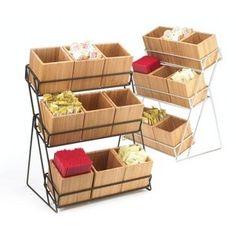 Expositor en cajas sobre soporte de hierros que añadidas ruedas puede ser movido fácilmente por el supermercado