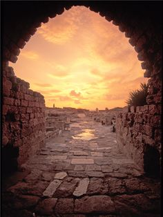 Crusader's Arch at sunset, Caesarea, Israel. The Crusader ruins date from the 11th and 12th centuries, and are among the country's most impressive. The walls around the city, which slope down precipitously from an imposing height, are perhaps the most awe-inspiring monument here, and it's easy to imagine the spectacle of hand-to-hand combat that took place here time and again. Inside the city are the ruins of Crusaders' homes and streets.