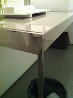 Bathroom desk. How the steels meets the surface.