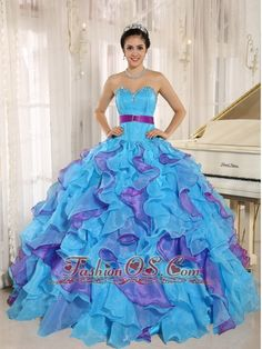 Stylish Multi-color Sweetheart Ruffles With Appliques 2013 Quinceanera Dress In New York  http://www.fashionos.com  The puffy and colorful skirt is a long and winding series of ruffles that begins at the hips and envelopes the legs in luxurious organza all the way to the floor. A lace up closure end the back. The sensational silhouette will look amazing as you waltz into prom.