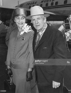 Casey Stengel, manager for the New York Yankees, and his wife before departing for their home in Glendale, California, from Idlewild Airport (now JFK), New York City.