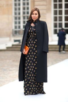 Beautiful maxi length dress and coat swung effortlessly over her shoulders in Paris.