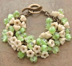 I don't know if I have the patience to individually wrap all those dangles!  A Handmade Floral Bracelet of Lovely Green Givre and Champagne Colored Czech Glass Beads.