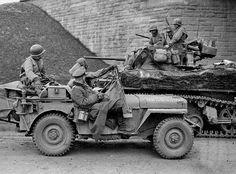 Jeep with officers of the Wehrmacht a prisoner along side a M5 Stuart tank of the United States in the town of Hersfeld, Germany 31st March 1945.