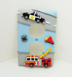 This cute emergency vehicle transportation themed light switch or outlet cover features a black and white police car and bright red fire engine - by Thimbletowne on Etsy.