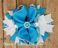 6 inch blue and white stacked OTT bow on lined alligator clip  https://www.facebook.com/1conniescustomcreations/